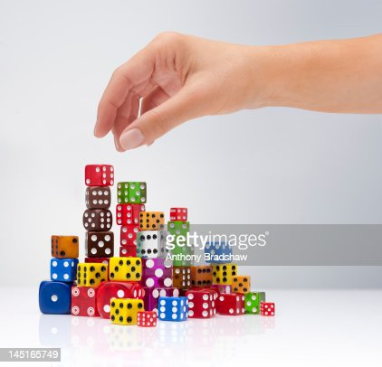 Hand selects a dice