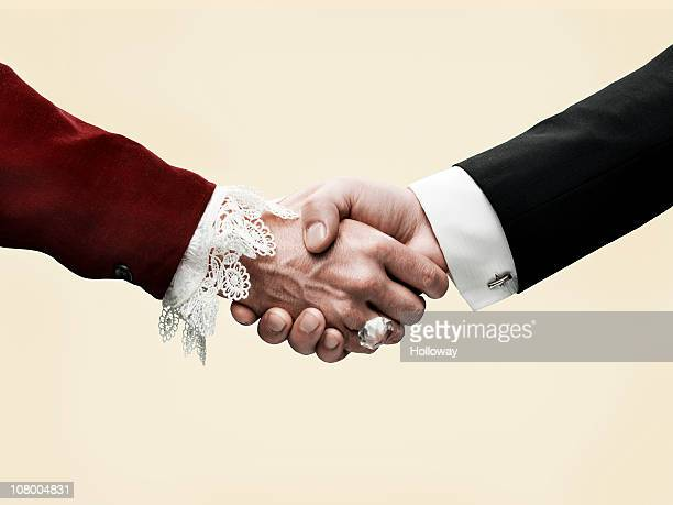 hand shake - long sleeved stock pictures, royalty-free photos & images