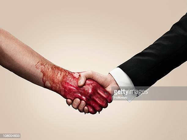 hand shake - cuff sleeve stock pictures, royalty-free photos & images