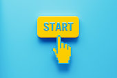 Hand Shaped Computer Cursor Clicking over A Yellow Push Button: Start Written on Push Button
