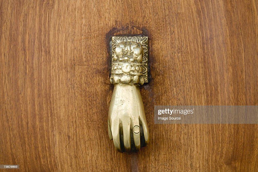 Hand shaped door handle : Stock Photo
