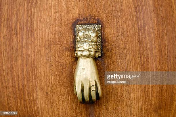 hand shaped door handle - door knocker stock photos and pictures