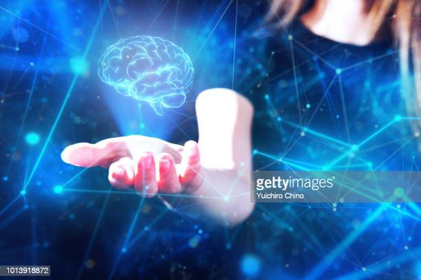 Hand showing a digital image of human brain in the network