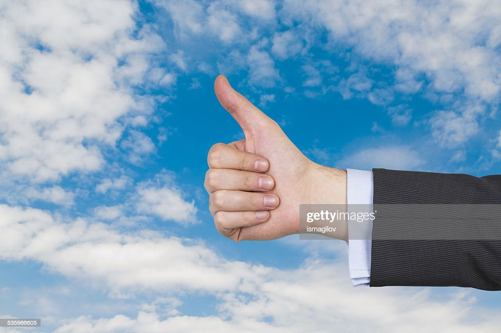 Hand showing thumb up : Stock Photo