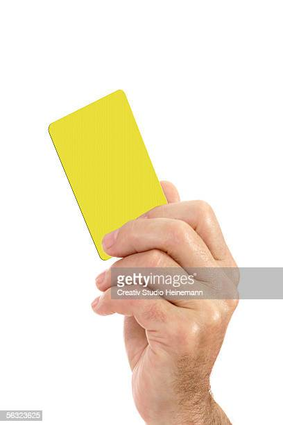 hand showing yellow card - yellow card stock pictures, royalty-free photos & images
