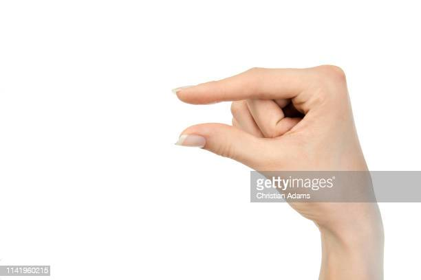 hand sign small - small stock pictures, royalty-free photos & images