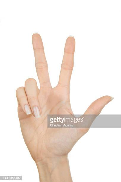 hand sign three - number 3 stock pictures, royalty-free photos & images