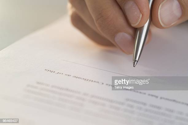 a hand signing on a line - permission concept stock pictures, royalty-free photos & images