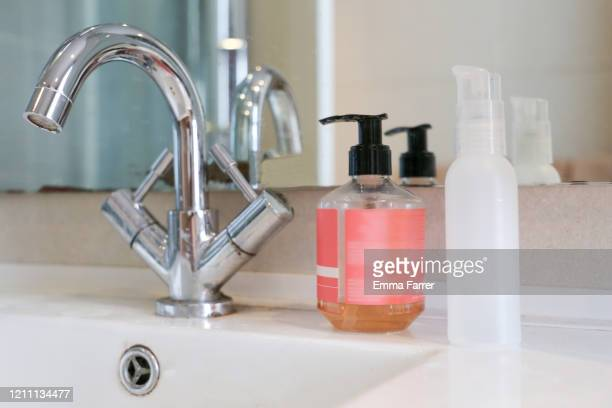 hand soap and hand sanitizer. - hand sanitiser stock pictures, royalty-free photos & images