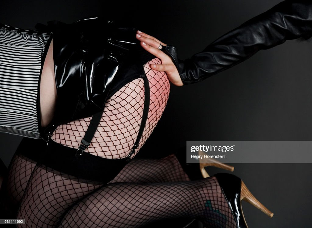 Hand Spanking Girl's Bottom : Stock Photo