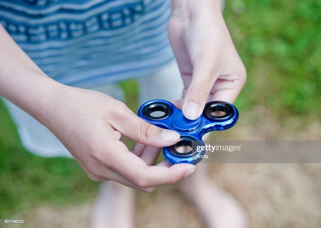 Hand Spinner. : News Photo