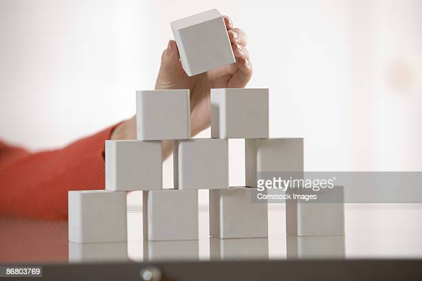 Hand stacking blocks