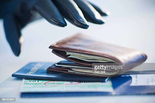 Hand Stealing Wallet, Tickets and Passport