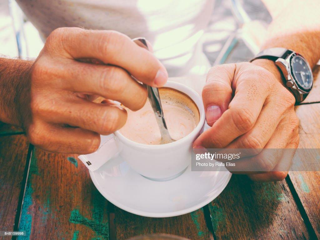 Hand stirring coffee : Foto de stock