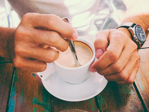Hand stirring coffee - gettyimageskorea