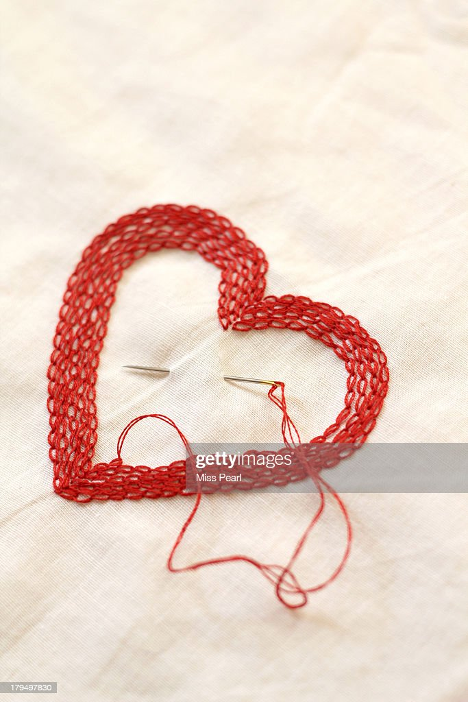 hand stitch heart with needle and thread ストックフォト getty images