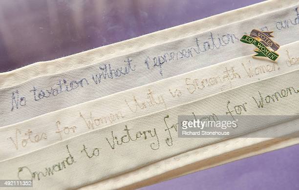 A hand stitched political messages on Sash is displayed at the former home of Emmeline Pankhurst and where the Suffragette movement began on October...