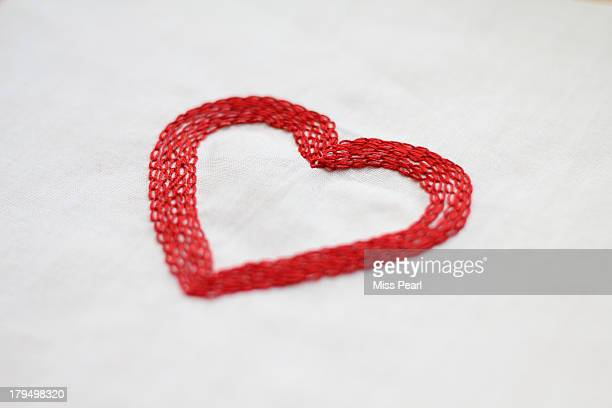 Hand stitched red love heart