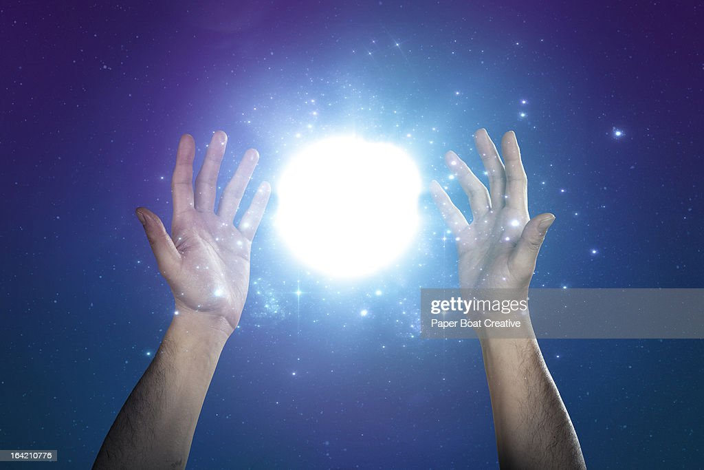 hand supporting abstract glow of light and stars : Stock Photo
