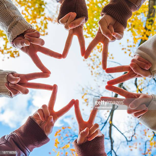 """hand symbol, big star with fingers. - """"martine doucet"""" or martinedoucet stock pictures, royalty-free photos & images"""