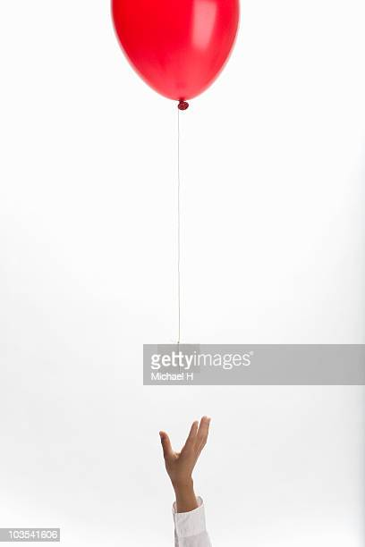 Hand that takes letter that reaches balloon