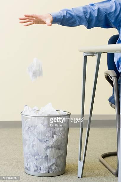 Hand Throwing Away Paper