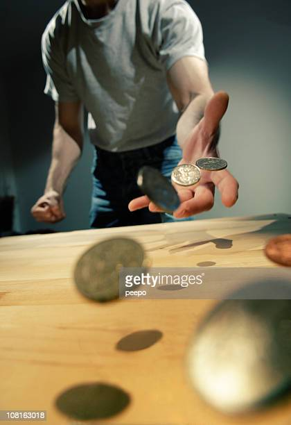 hand throwing coins