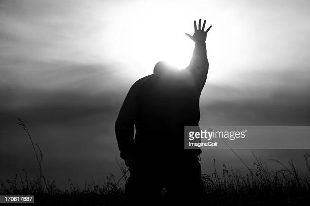 hand to heaven in worship with god rays - praying stock pictures, royalty-free photos & images