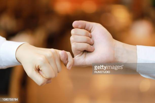 Hand to pinky swear, pinky promise hand signs