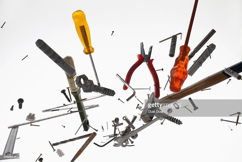 Hand tools and equipment against a white background : Stock Photo