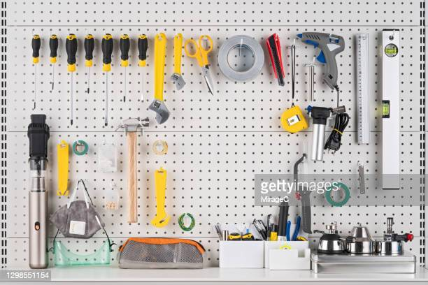 hand tools hanging on pegboard with space - tidy room stock pictures, royalty-free photos & images