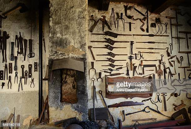 Hand Tools On Wall At Workshop