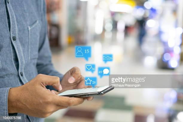 hand touch screen smart phone. application icons interface on screen. social media concept - social network foto e immagini stock