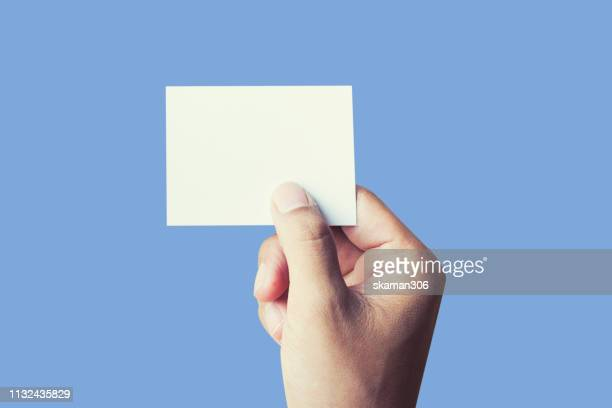 hand touching blank notepad with pastel color background - greeting card bildbanksfoton och bilder