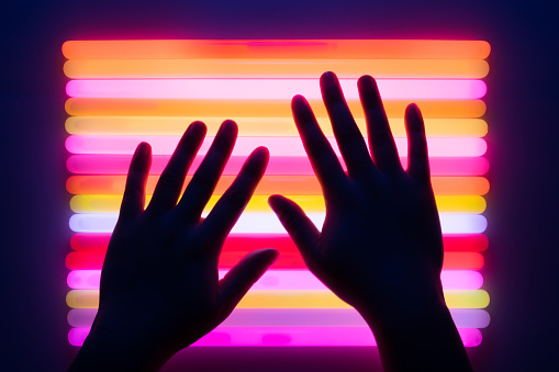 Hand Touching Colorful Glow Sticks - gettyimageskorea