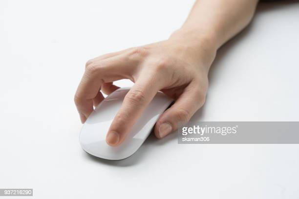 Hand touching computer mouse