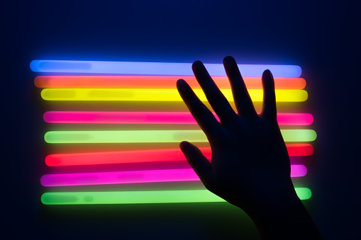 Hand Touching Glow Sticks - gettyimageskorea