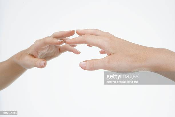 Hand touching mirror, close-up