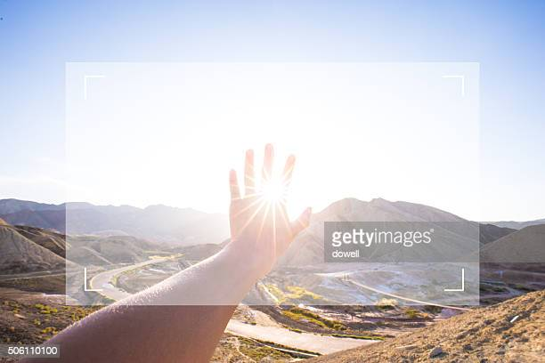 hand touching screen background  landscape of valley