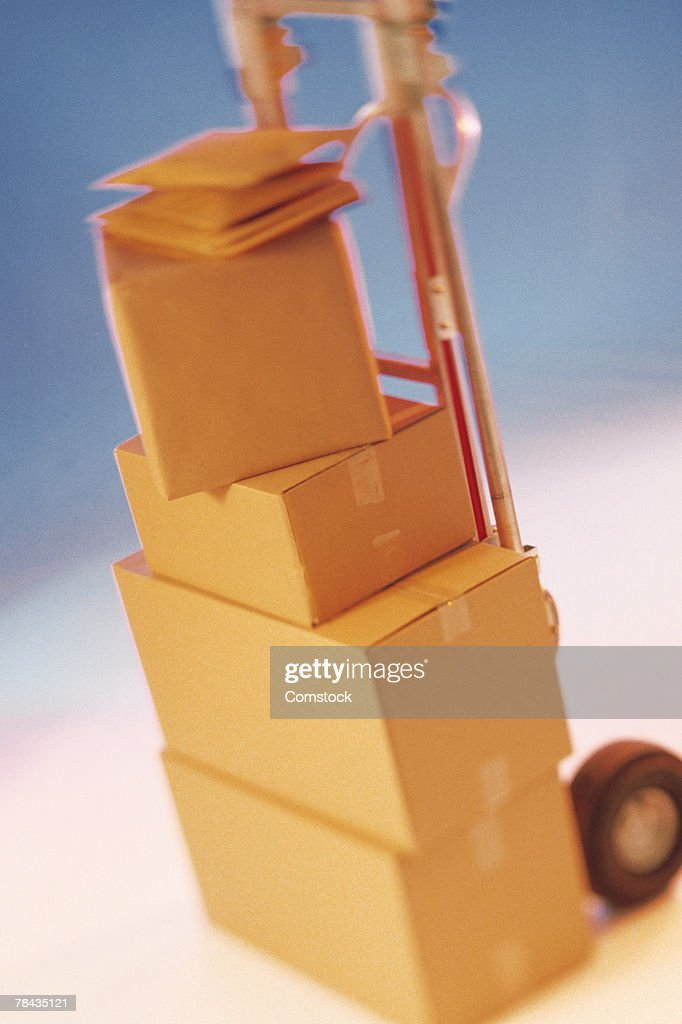 Hand truck stacked with boxes : Stockfoto