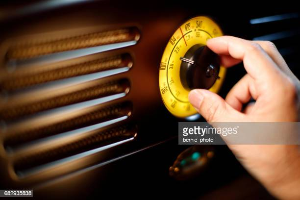 hand tuning fm retro radio knob - radio stock pictures, royalty-free photos & images