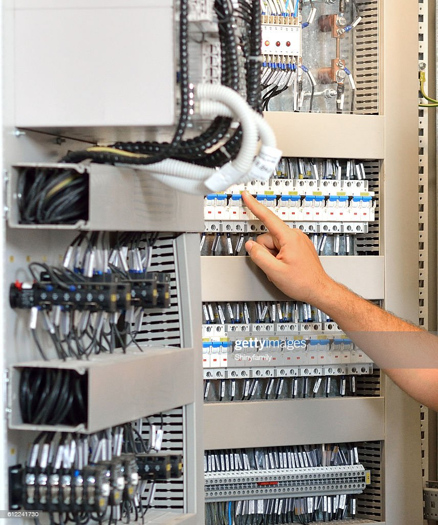Hand Turning In Or Off A Fuse Box Switch Stock Photo Getty Images Electrician