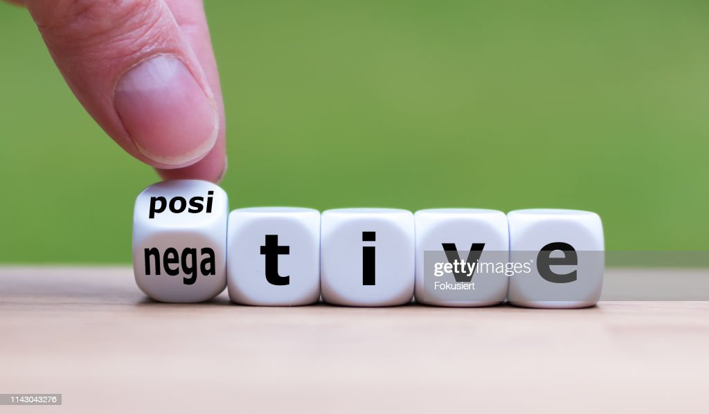 "Hand turns a dice and changes the expression ""negative"" to ""positive"". : Stock Photo"
