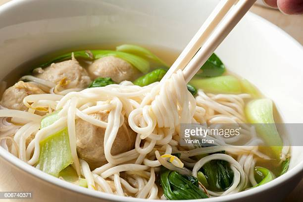 Hand Twirling Noodles from Shanghai Noodle Meatball Soup onto Chopsticks