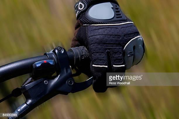 Hand using a bike brake