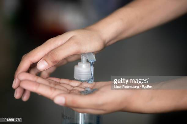 hand using alcohol gel clean and wash hand sanitizer anti virus bacteria. - alcool gel imagens e fotografias de stock