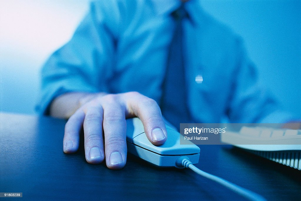 Hand using computer mouse : Stock Photo