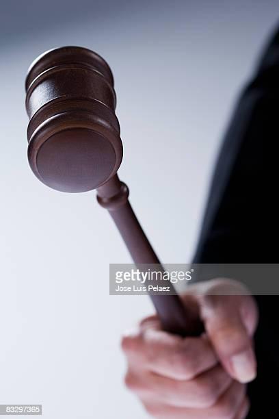 Hand using judge's gravel