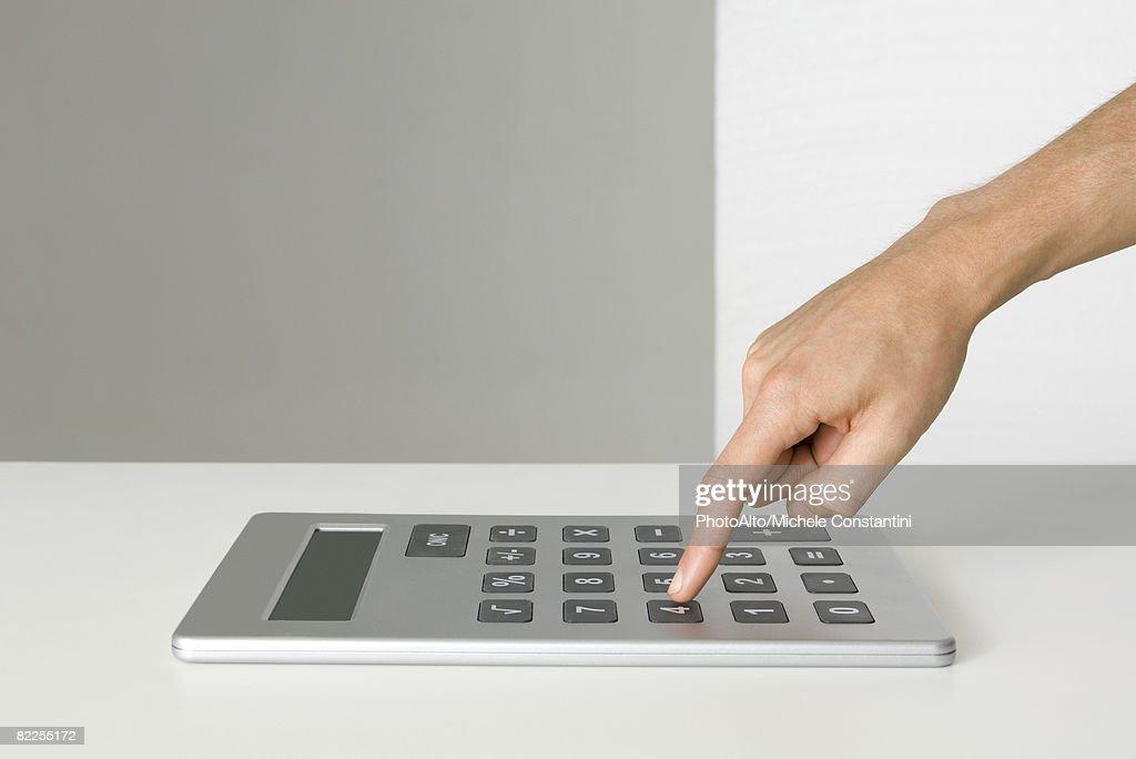 Hand using oversized calculator : Stock Photo