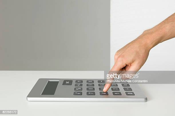 hand using oversized calculator - pushing stock pictures, royalty-free photos & images